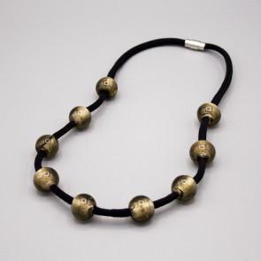 Collana elastica con perle di vetro
